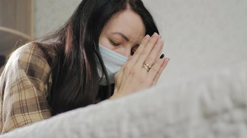 Young Woman in Protective Mask with Praying Hands Asks God for Healing Recovery During Disease