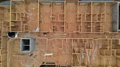 Construction Site with Wooden Framework of Urban Apartment Complex