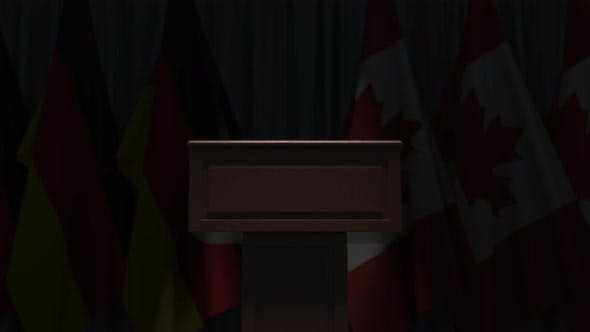 Flags of Canada and Germany and Speaker Tribune