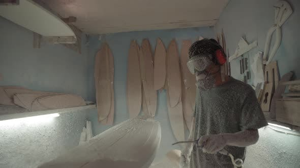 Professional Craftsman Making Surfboard