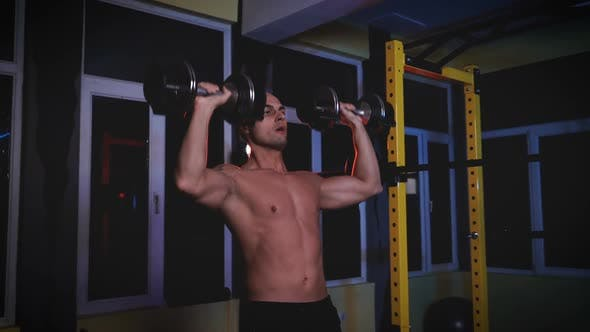 Thumbnail for Athlete Muscular Male Bodybuilder Training with Heavy Weights or Dumbbells in a Sports Club or Gym