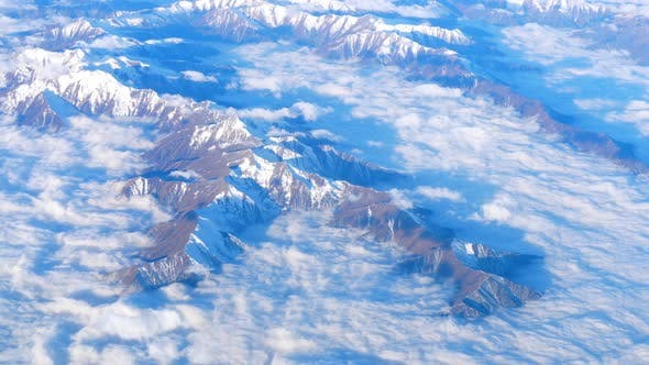 Thumbnail for Beautiful View Through Airplane Window, Airplane Flying Above Mountains with Clouds