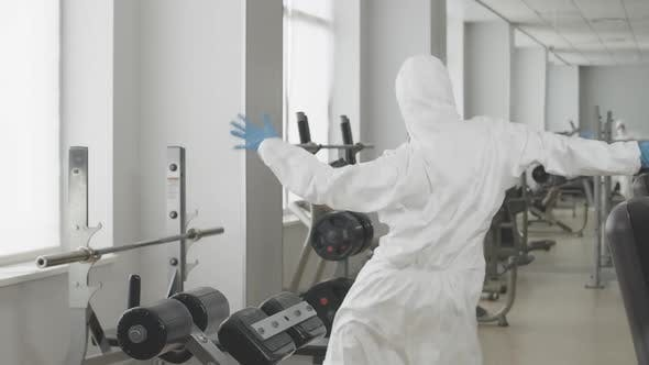 Thumbnail for Funny Dance of Positive Caucasian Woman in Protective Suit and Respirator in Gym. Portrait of