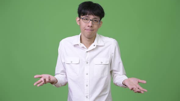 Thumbnail for Young Asian Businessman Shrugging Shoulders