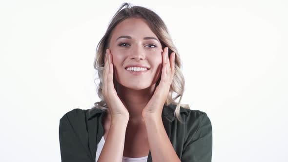 Attractive Woman Touching Her Cheeks