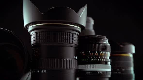 Thumbnail for Macro Cinematic Reveal Of Camera Lenses On Black Background