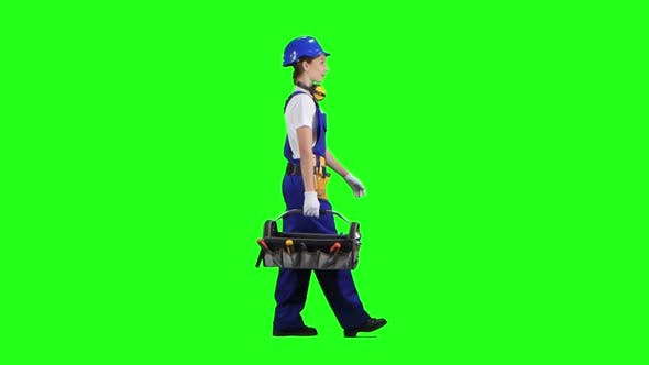 Thumbnail for Professional Girl Carries a Case with Construction Tools. Green Screen. Side View