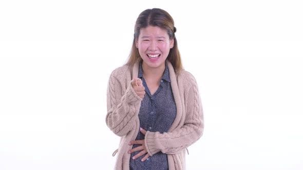 Thumbnail for Happy Young Asian Woman Smiling and Laughing Ready for Winter