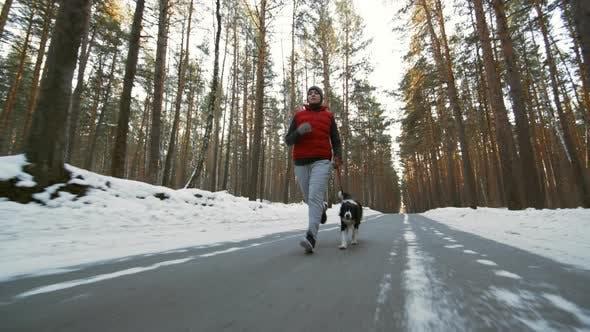 Thumbnail for Female Dog Owner Running in Woods