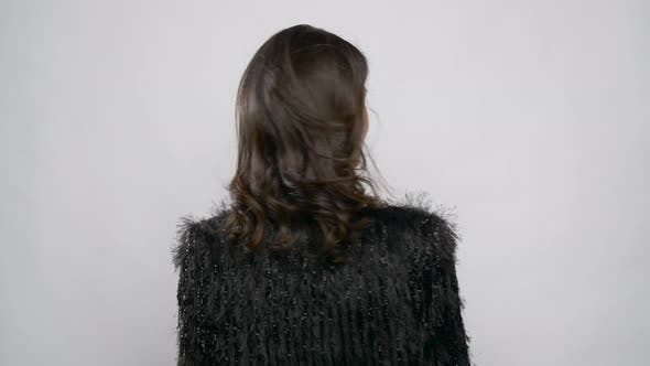 Woman in Party Clothes Turning Back