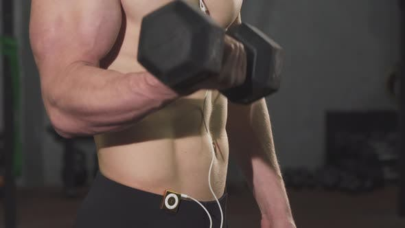 Thumbnail for Cropped Shot of a Muscular Man with Stunning Body Lifting Dumbbell