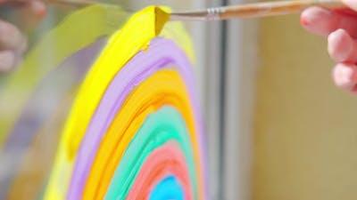 Painting Rainbow at Home Window