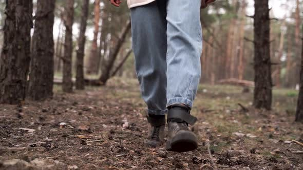 Thumbnail for Tourist walks through forest. Closeup tourist legs in dark shoes. Walking hiking travelin