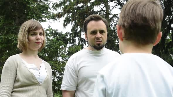 Thumbnail for Parents, Middle Age Couple, Are Angry at a Child, Boy in the Park