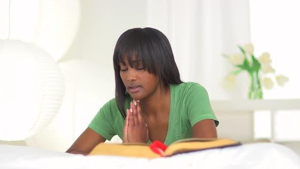 Thumbnail for African woman praying