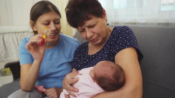 Thumbnail for Three Generations Grandmother Mother And Granddaughter