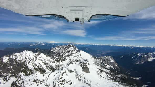 Thumbnail for Panoramic View Above Cascade Mountain Range With Camera Mounted Under Helicopter
