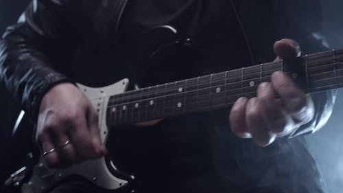 Close Up Of Playing The Guitar With A Pick