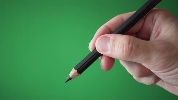 Man Holding Pencil In His Hand Isolated On Chroma Key Green Screen Background