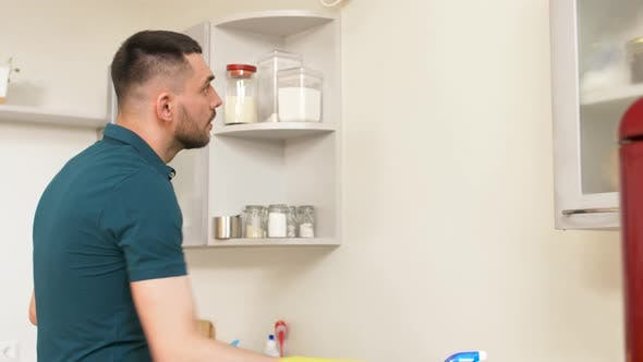 Thumbnail for Man Cleaning Wall with Detergent at Home Kitchen 3