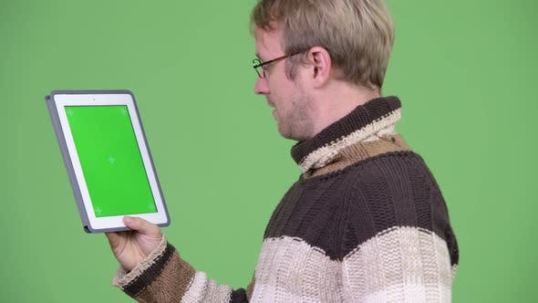 Cover Image for Profile View of Happy Handsome Man Using Digital Tablet
