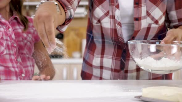 Thumbnail for Close Up of Woman Spreading Flour on the Table