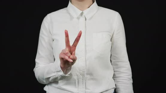 Thumbnail for Hand of a woman showing victory sign