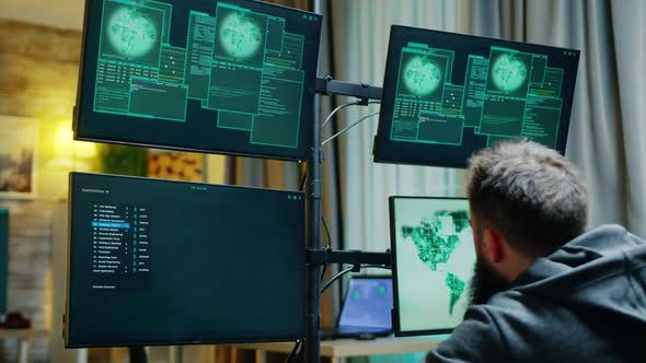 Zoom in Shot of Male Hacker Trying To Hack a Firewall