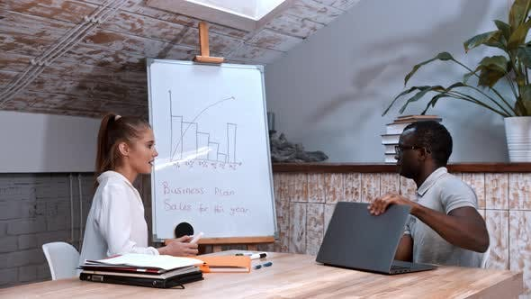 Thumbnail for African-american Man and Caucasian Woman at the Business Meeting - Discussing the Plan