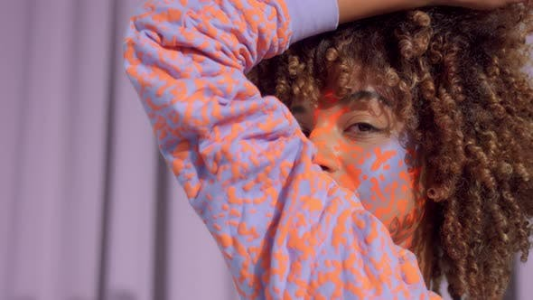 Thumbnail for Mixed Race Woman with Curly Hair and Bright Neon Makeup Pattern on the Face the Same Like on Her