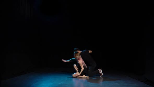 Thumbnail for Romantic Choreography Against Black Background in Spotlight at Studio, Slow Motion.