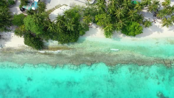 Thumbnail for Luxury flying abstract shot of a white sand paradise beach and turquoise sea background in vibrant 4