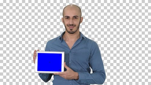 Smiling casual man presenting a tablet with a blank screen