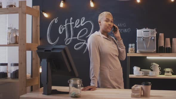 Thumbnail for Coffee Seller Talking On Phone