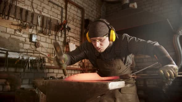 Thumbnail for A Man Blacksmith Forging a Knife in Workshop