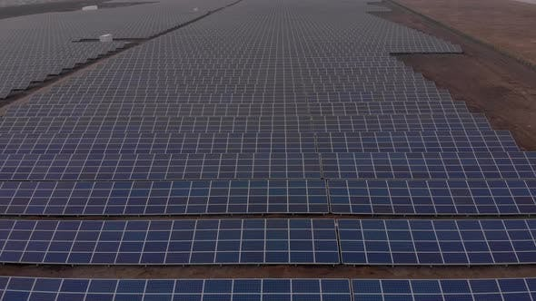 Thumbnail for Aerial Drone View Into Large Solar Panels at a Solar Farm, Solar Cell Power Plants, Footage Video