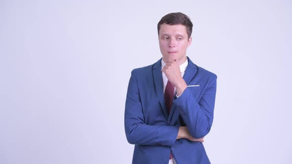 Thumbnail for Serious Young Businessman Thinking and Looking Down