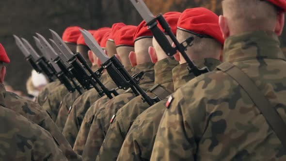 Thumbnail for Soldiers with Machine Guns and Bayonet Knives Stand in a Row, in Red Berets