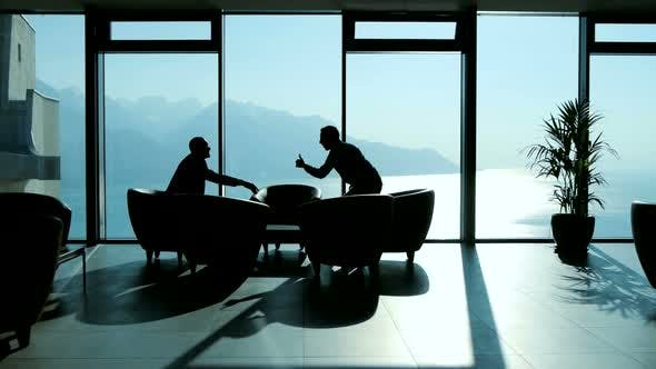 Thumbnail for Business People Meeting in Modern Lobby Office Hall Talking Together about Financial Investment Deal