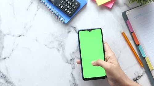 Top View of Women Hand Using Smart Phone with Stationary on Table