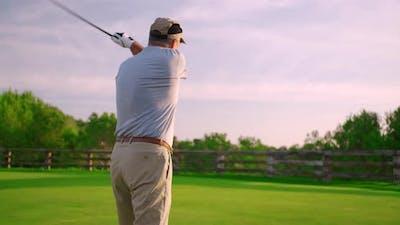 Handsome Older Golfer Swinging Golf Club, Golfing in Paradise.