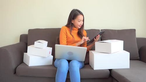 Woman with packing box ready for shipping