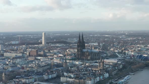 Thumbnail for AERIAL: Wide Shot of Cologne Germany From the Air with Majestic Cathedral on Sunny Day