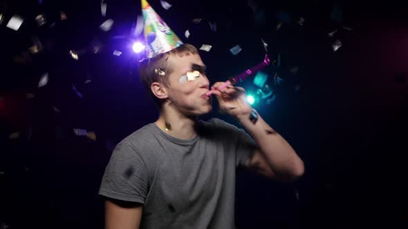 Guy Throwing Glitter Confetti, Blowing Party Whistle and Dance, Close-up