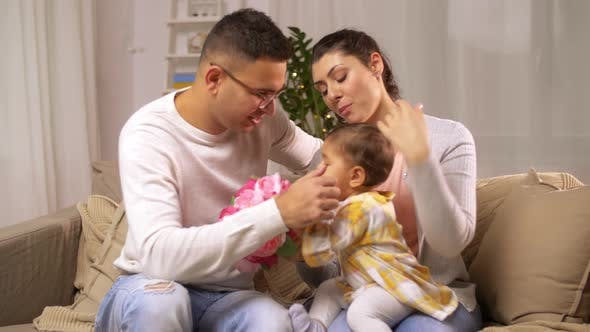 Thumbnail for Family with Baby Daughter and Flowers at Home 7