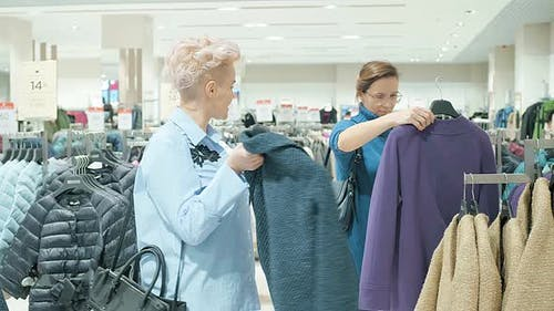 Two Women at a Boutique Choosing a Dress