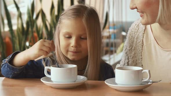 Thumbnail for Little Girl Moves Spoon in the Cup
