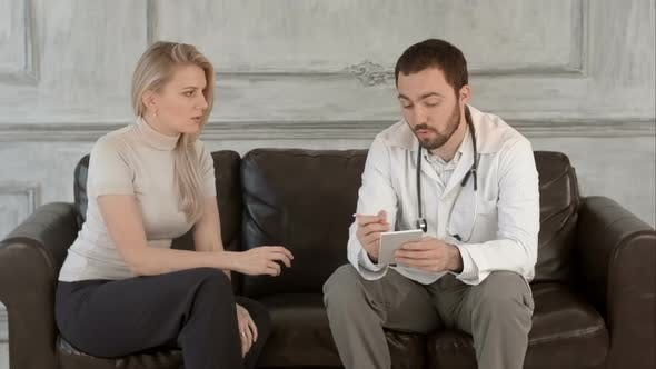 Thumbnail for Patient and Doctor Taking Notes on a Green Screen, Chroma Key