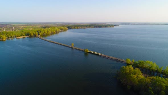 Thumbnail for Flying Over the River Dam. Aerial Camera Shot. Ukraine