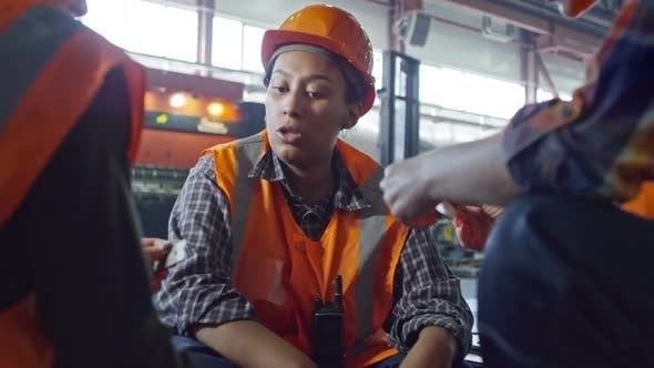 Thumbnail for Experienced Female Technician Speaking with Colleagues